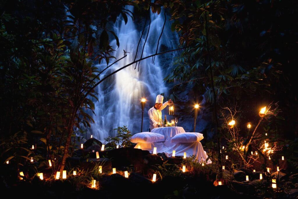 Chef preparing private dinner over waterfall